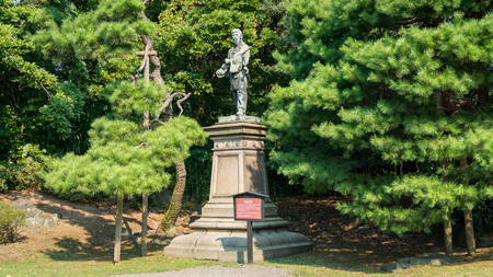 Tokyo, Japan - August 2018: Umashimadenomikoto statue in Hamarikyu Gardens, a large and attractive garden in Tokyo, Chuo district, Sumida River, Japan