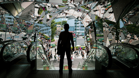 Tokyo, Japan - August 2018: Silhouette Male traveler at Omotesando Tokyo Plaza building in Harajuku, Tokyo, Japan. Tokyu Plaza is a fashion theme park shopping mall for the trendiest fashion.