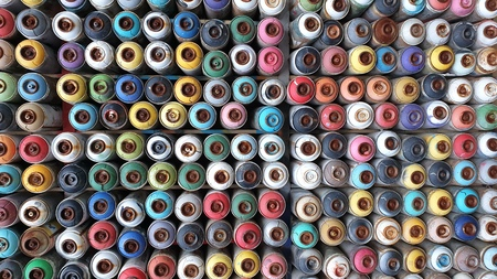 Wall of colored spray cans stacked together Stok Fotoğraf