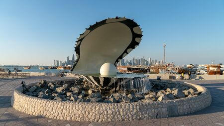 Doha, Qatar - February 2019: Pearl and oyster fountain landmark monument on the Corniche