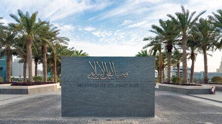 Doha, Qatar - February 2019: Signage at the entrance of Museum of Islamic Art. The building was designed by architect I. M. Pei is located on the Doha Corniche. Stok Fotoğraf - 128024397