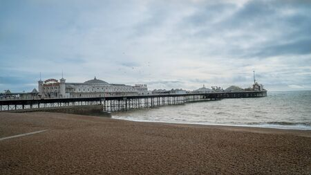 Brighton and Hove, Sussex, UK - January 2019: The Brighton Pier, also known as the Palace Pier, is a Grade 2 listed pleasure pier in Brighton, England that first opened in 1899.