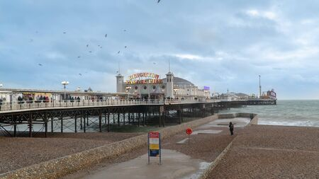 Brighton and Hove, Sussex, UK - January 2019: The Brighton Pier, also known as the Palace Pier, is a Grade 2 listed pleasure pier in Brighton, England that first opened in 1899. Stok Fotoğraf - 128024491