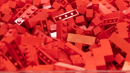London, UK - January 2019: Red Lego blocks, plastic construction toy, manufactured by The Lego Group based in Denmark - illustrative editorial