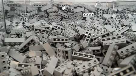 London, UK - January 2019: Grey Lego blocks, plastic construction toy, manufactured by The Lego Group based in Denmark - illustrative editorial