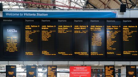 London, United Kingdom - January 2019: Timetable listing the many train connections at Victoria Station Editöryel