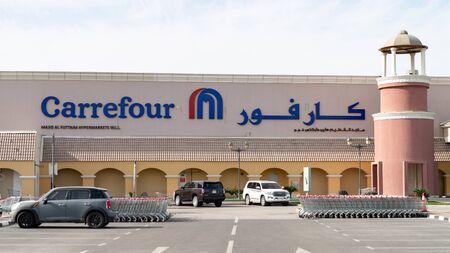 Doha, Qatar - February 2019: French international hypermarket chain Carrefour store logo in Doha, Qatar
