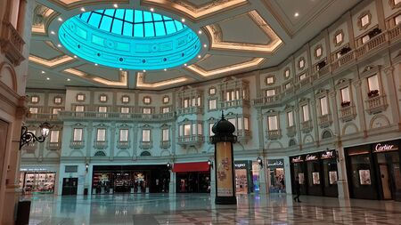Doha, Qatar - February 2019: Interior scene from Villaggio shopping mall in Doha with many stores and shops Stok Fotoğraf - 128024527