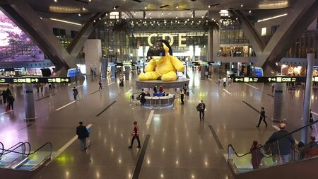 Doha, Qatar - February 2019: Indoors interior of new Hamad International Airport in sector with a big yellow bear