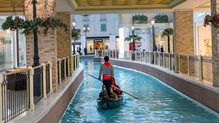 Doha, Qatar - February 2019: Interior scene from Villaggio shopping mall in Doha with many stores and shops
