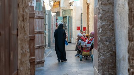 Doha, Qatar - February 2019: Located in the center of Doha, the Souq Waqif is a market selling traditional Arab clothing, jewelry and souvenirs.