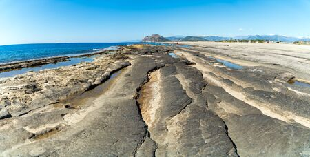 Natural rock formations at Koru beach with people by the mediterranean sea, Gazipasa, Antalya province in Turkey