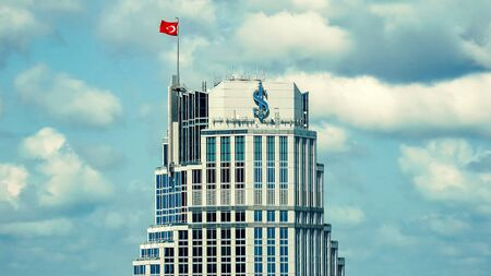 Istanbul Turkey - September 2018: Top floors of Isbank headquarters tower in Levent, istanbul, Turkey Stok Fotoğraf - 128024998
