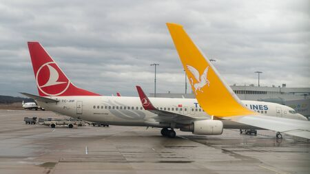Istanbul, Turkey, April 2019: Pegasus airlines and Turkish airlines airplanes waiting on a terminal on new Istanbul Airport
