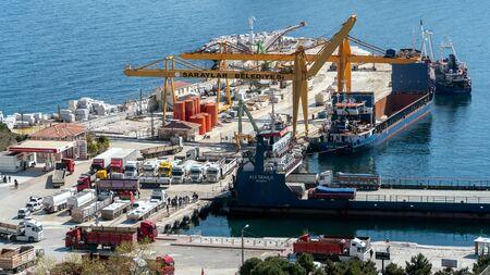 Marmara island - Turkey - April 2019: Marmara island harbour where marble products are loaded to cargo ships, Balikesir, Turkey