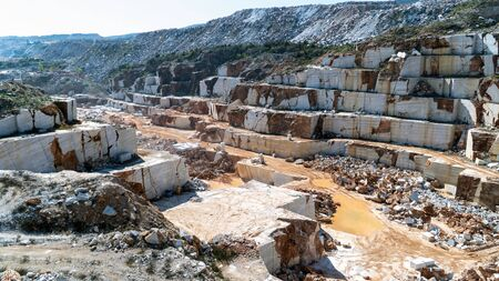 Marble quarry pit full of rocks and blocks in Marmara island, Balikesir, Turkey 写真素材