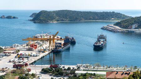 Marmara island - Turkey - April 2019: Marmara island harbour where marble products are loaded to cargo ships, Balikesir, Turkey Stok Fotoğraf - 128025012