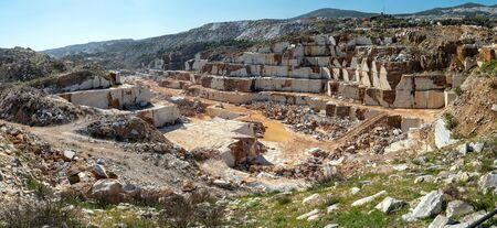 Panoramic view of marble quarry pit full of rocks and blocks in Marmara island, Balikesir, Turkey