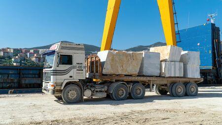 Marmara island - Turkey - April 2019: Marble blocks being transferred on a truck in Marmara island, Turkey Editorial