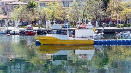 Marmara Island, Turkey - April 2019: Marmara island view with boats. Marmara island is 2 hours away from istanbul with ferryboat, in the Marmara sea, Turkey Stok Fotoğraf - 128025015