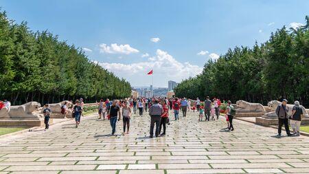 Ankara, Turkey - August 2019: People walk in Road of Lions to reach Anitkabir mausoleum of Mustafa Kemal Ataturk. Many people visit Anitkabir every year. Stock Photo - 130762687