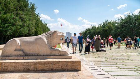 Ankara, Turkey - August 2019: People walk in Road of Lions to reach Anitkabir mausoleum of Mustafa Kemal Ataturk. Many people visit Anitkabir every year. Stock Photo - 130762686