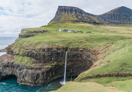 Mulafossur waterfall in Gasadalur, Vagar Island of Faroe Islands. 写真素材