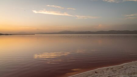 Sunset over the coast of Maharloo pink lake in Shiraz, Iran