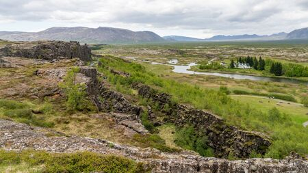 View over tectonic plates and creek in Thingvellir National Park in Iceland