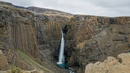 Hengifoss waterfall with natural basalt column formations, Egilsstadir, Iceland