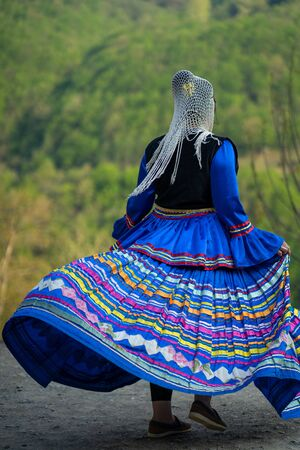 Unidentified Iranian woman in traditional Persian clothes, Masuleh village, Gilan province, Iran