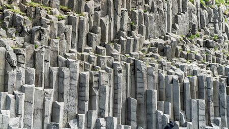 Basalt columns geological formation at Reynisfjara beach, southern coast of Iceland