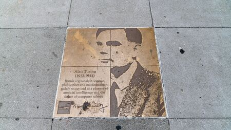 San Francisco, USA - August 2019: Tribute bronze plaque on rainbow honor walk to Alan Turing, the mathematician on the pedestrian sidewalk of Castro district, San Francisco, USA