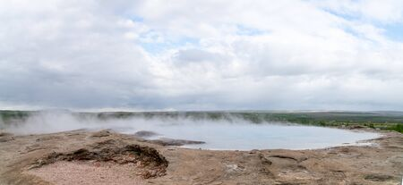 Geothermal area of Strokkur in Iceland with hot boiling thermal water smoke