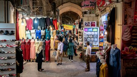 Isfahan, Iran - May 2019: Tourists and local people shopping in Bazar Bozorg, also known as the Grand Bazaar, which is a historical market