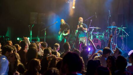 Istanbul, Turkey - January 2020: Athena the Turkish rock band in concert in a night club with crowded audience, Istanbul, Turkey