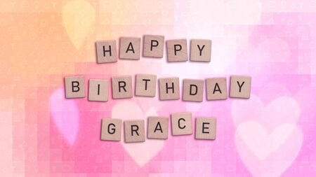 Happy Birthday Grace card with wooden tiles text. Girls birthday card in rainbow colors. This image can be used for a eCard or a print postcard. Stock Photo