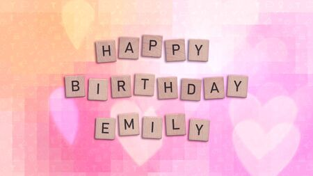 Happy Birthday Emily card with wooden tiles text. Girls birthday card in rainbow colors. This image can be used for a eCard or a print postcard. Stock Photo