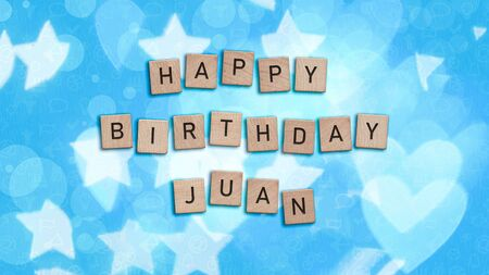 Happy Birthday Juan card with wooden tiles text. Boys birthday card in blue. This image can be used for a eCard or a print postcard.