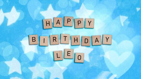 Happy Birthday Leo card with wooden tiles text. Boys birthday card in blue. This image can be used for a eCard or a print postcard.
