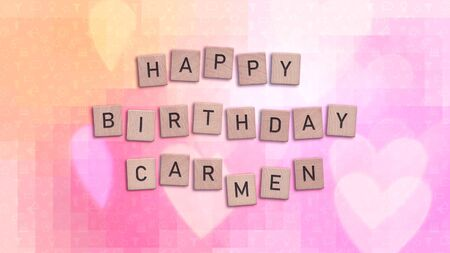 Happy Birthday Carmen card with wooden tiles text. Girls birthday card in rainbow colors. This image can be used for a eCard or a print postcard.