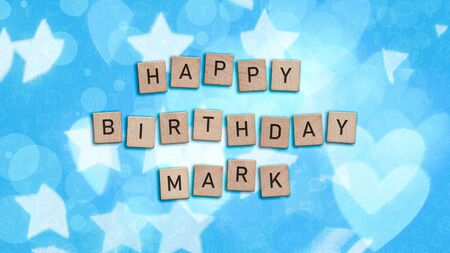 Happy Birthday Mark card with wooden tiles text. Boys birthday card in blue. This image can be used for a eCard or a print postcard.
