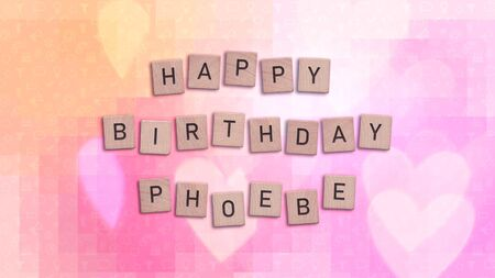 Happy Birthday Phoebe card with wooden tiles text. Girls birthday card in rainbow colors. This image can be used for a eCard or a print postcard.