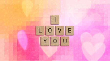 I love you written with wooden tiles over colorful background with heart shapes. This image can be used for a banner or a print postcard. 版權商用圖片