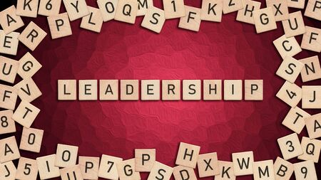 Leadership written with wooden tiles over red background. This image can be used for a banner or a print postcard.