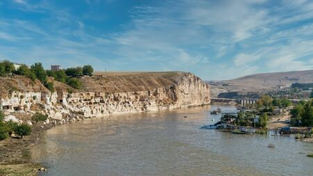 Hasankeyf, Turkey - October 2019: Remains of the town of Hasankeyf on the River Tigris, famous with stone caves after it is evacuated. The town will be sunk under water of ilisu dam