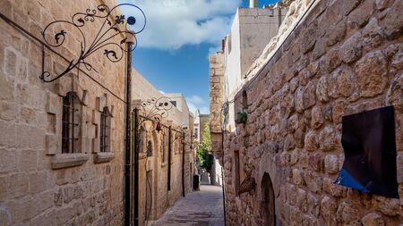 Mardin, Turkey - January 2020: Narrow stone streets of old town Mardin