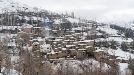 Remote village in Eastern Turkey Anatolia with stone houses, snowy landscape, Hizan, Bitlis, Turkey