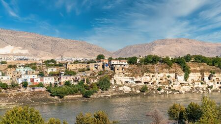 Remains of the town of Hasankeyf on the River Tigris, famous with stone caves after it is evacuated. The town will be sunk under water of ilisu dam Stock Photo