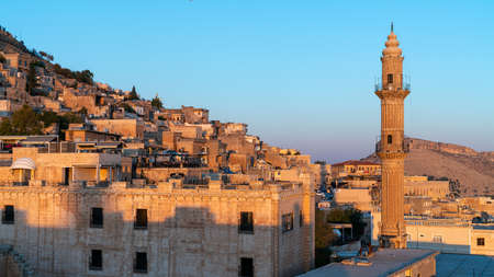 Mardin, Turkey - January 2020: Mardin old city cityscape with Sehidiye mosque minaret Editorial